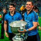 Bernard and Alan Brogan with the Sam Maguire after Dublin's victory over Kerry. Picture credit: David Maher / SPORTSFILE