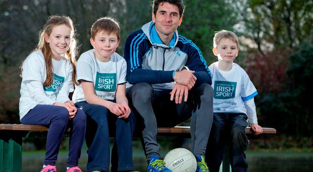 Grace Galvin (9), Finn McCluskey (8) and Conn McCluskey (5) with Federation of Irish Sport president and Dublin footballer Bernard Brogan at the launch of the group's Annual Review. Photo: ©INPHO/Morgan Treacy