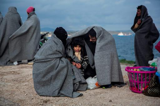 A Syrian family try to keep warm on the Greek island of Lesbos. Photo: AP