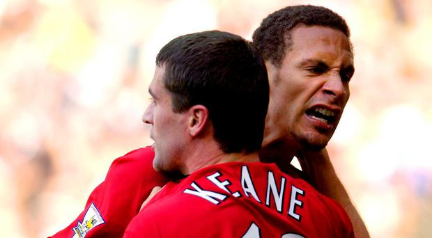 Rio Ferdinand with Roy Keane in 2003. Photo: AFP/Getty Images