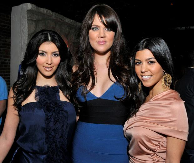 March 2008: (L-R) Television personalities and sisters Kim Kardashian, Khloe Kardashian, and Kourtney Kardashian attend the season two launch of 'Keeping Up With The Kardashians' at Les Deux