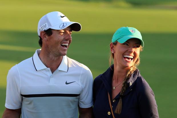 Rory McIlroy celebrates with his girlfriend Erica Stoll after winning the DP World Tour Golf Championship in Dubai last month (Karim Sahib/AFP/Getty)