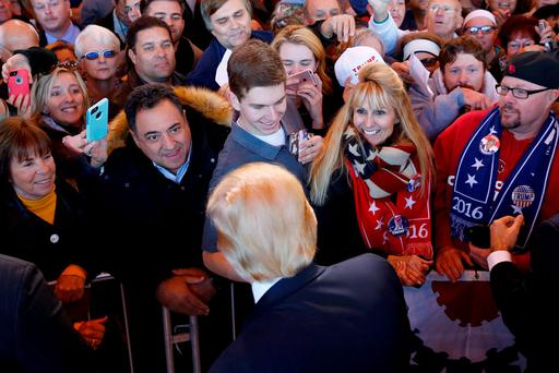 Republican presidential candidate Donald Trump – who now leads all of his Republican rivals in most polls – is greeted by delighted supporters at a campaign rally in Mesa, Arizona. Photo: Reuters/Nancy Wiechec