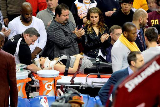 Ellie Day, wife of golfer Jason Day (not pictured), leaves the arena on a stretcher after she was run into by Cleveland Cavaliers forward LeBron James (not pictured) while she sat in the front row during a game between the Cleveland Cavaliers and the Oklahoma City Thunder at Quicken Loans Arena. Credit: David Richard-USA TODAY Sports