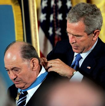 Highest honour: George W Bush gives the Medal of Honor to Tibor Rubin during a ceremony at the White House in 2005