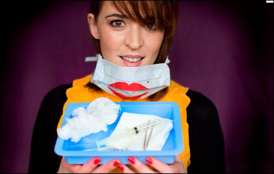 Artist in operation: Aoife Moggan playfully uses medical paraphernalia to create her own quirky photographs. Photo: David Conachy.