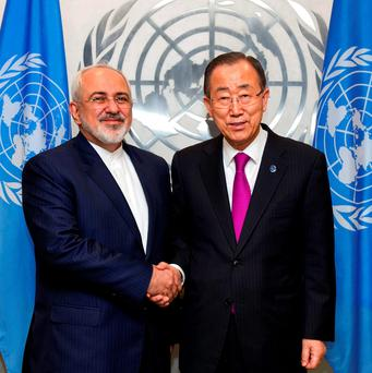 In this photo provided by the United Nations, Iranian Foreign Minister Mohammad Javad Zarif, left, is greeted by United Nations Secretary-General Ban Ki-moon at United Nations headquarters (Rick Bajornas/The United Nations via AP)