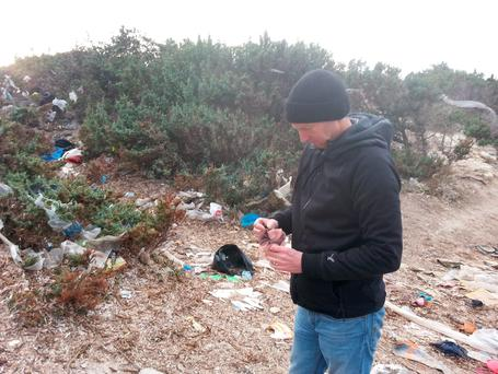 GOAL Chief Executive Barry Andrews on a beach outside Izmir, Turkey, strewn with the discarded effects of refugee families attempting to enter Europe via Greece