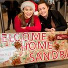 Caoimhe and Lorraine Moran wait to welcome their sister Sandra home from New York for the first time in eleven years at Dublin Airport. Photo: Tony Gavin