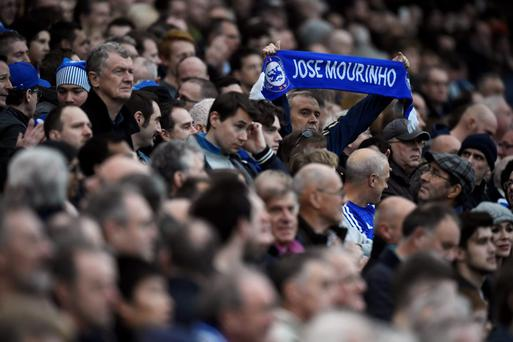 Chelsea fan holds up a scarf for Jose Mourinho at Stamford Bridge today