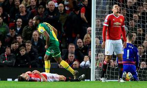 Norwich City's Cameron Jerome celebrates scoring his goal at Old Trafford
