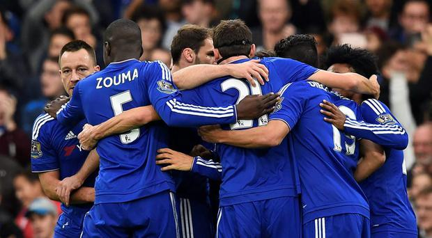 Pedro (hidden) celebrates with team mates after scoring the second goal for Chelsea