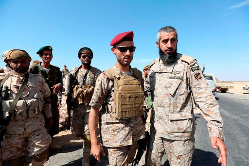 Commander of the First Infantry Brigade in the Yemeni army, Brigadier Hashim al-Ahmar (2nd R), and a Saudi army officer (R) tour and area taken by forces loyal to Yemen's President Abd-Rabbu Mansour Hadi from Houthi rebels in Majaz district of Yemen's northwestern province of Marib, December 18, 2015. REUTERS/Ali Owidha