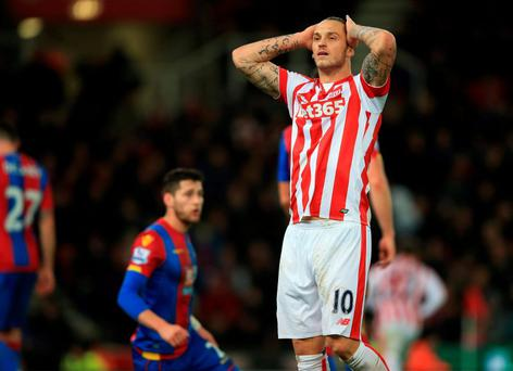 Stoke City's Marko Arnautovic stands dejected