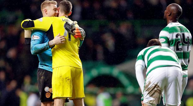 Motherwell's Connor Ripley hugs Celtic's Craig Gordon after the game