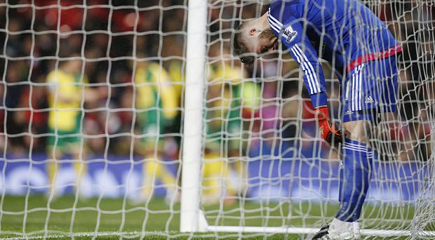 Manchester United's David De Gea looks dejected after Alexander Tettey (not pictured) scores the second goal for Norwich