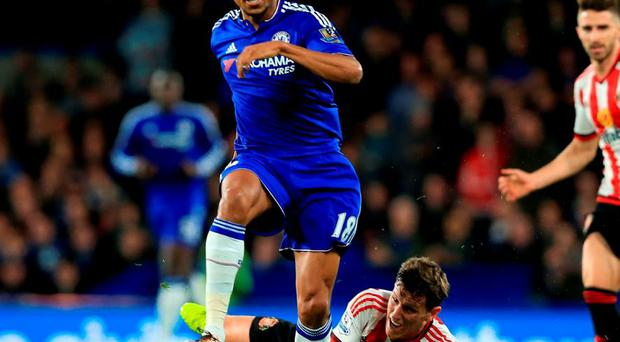 Chelsea's Loic Remy and Sunderland's Billy Jones in action during yesterday's Premier League match at Stamford Bridge. Photo: Adam Davy