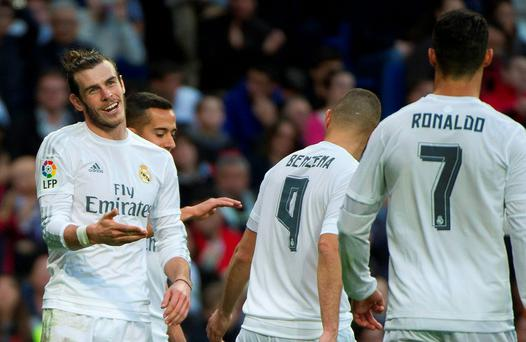 Real Madrid's Gareth Bale celebrates with teammates after scoring against Rayo Vallecano