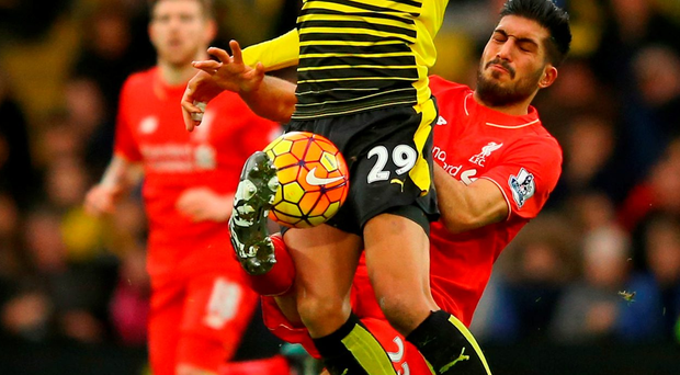 Etienne Capoue of Watford is tackled by Emre Can. Photo: Richard Heathcote/Getty Images
