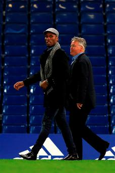 Didier Drogba and Guus Hiddink may their way to meet the Chelsea players after Saturday's match at Stamford Bridge. Photo: Adam Davy/PA Wire