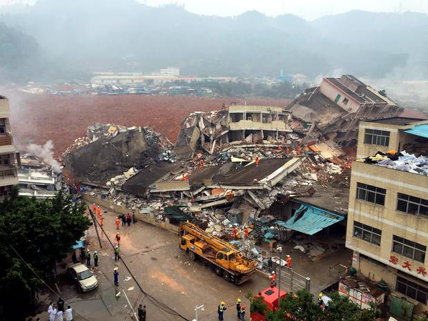 Rescuers search for survivors amongst collapsed buildings after a landslide in Shenzhen, in south China's Guangdong province, Sunday, Dec. 20, 2015