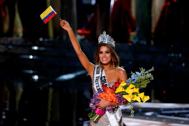 Miss Colombia Ariadna Gutierrez waves the Columbian national flag after initially being crowned as the winner during the 2015 Miss Universe Pageant in Las Vegas, Nevada December 20, 2015