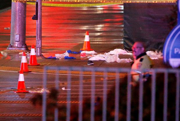 Police and emergency crews respond to the scene of a car accident along Las Vegas Boulevard, Sunday, Dec. 20, 2015, in Las Vegas