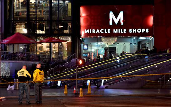 Las Vegas police investigate following a traffic crash in front of the Planet Hollywood Hotel, near the hotel and casino where the Miss Universe pageant was being held, in Las Vegas, Nevada December 20, 2015