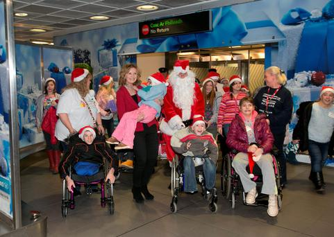 Adi Roche with Yana Bardouskaya (10) at Dublin Airport where 30 children from the Chernobyl region of Belarus arrived to begin a two week Christmas holiday with host families around the country.