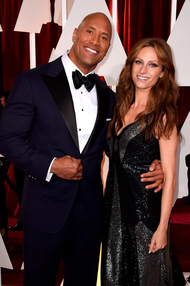 Actor Dwayne 'The Rock' Johnson (L) and singer Lauren Hashian the 87th Annual Academy Awards at Hollywood & Highland Center on February 22, 2015 in Hollywood, California. (Photo by Frazer Harrison/Getty Images)