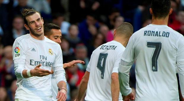 Real Madrid's Welsh forward Gareth Bale (L) celebrates with teammates after scoring during the Spanish league football match Real Madrid CF vs Rayo Vallecano yesterday