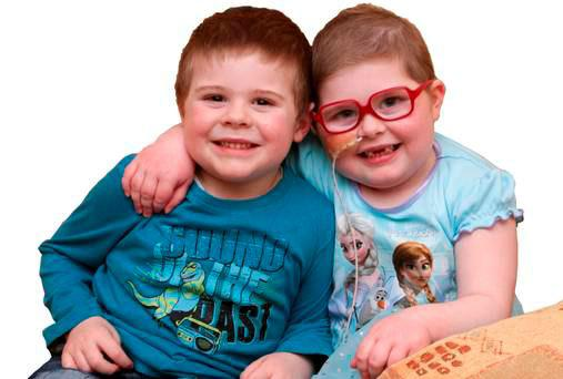 Little Cian O'Farrell (5) and his older sister Ciara (6)