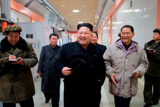 North Korean leader Kim Jong Un (C) visits the January 18 General Machinery Plant in this undated photo released by North Korea's Korean Central News Agency (KCNA) in Pyongyang
