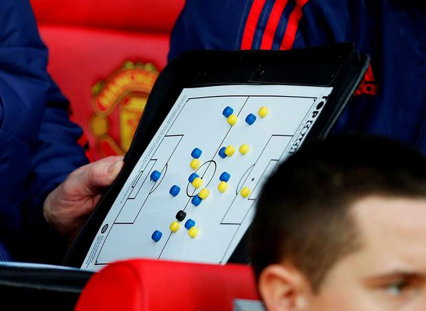 Louis van Gaal holds his clipboard during Saturday's defeat by Norwich