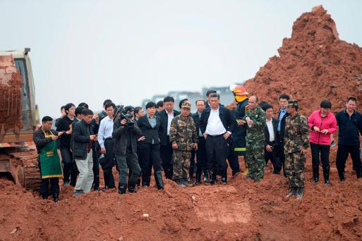 Ma Xingrui (front, 3rd R), municipal party secretary of Shenzhen, and other officials visit the site after a landslide hit an industrial park in Shenzhen, Guangdong province, December 21, 2015
