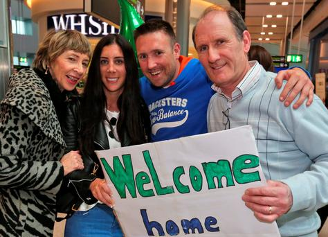 Maria Donohue and Shane Farrell who are returning from Sydney and got engaged in Bangkok are welcomed home by Maria's mother, Kay and Shane's father, Kieran pictured at Dublin Airport