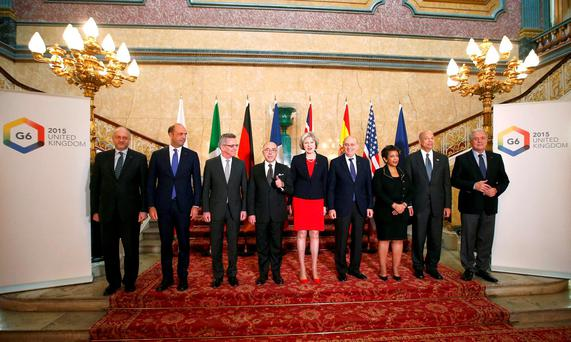 Britain's Home Secretary Theresa May (C) poses for a group photo with Spain's Interior Minister Jorge Fernandez Diaz (To right of May), U.S. Attorney General Loretta Lynch (3rd R) and Secretary of Homeland Security Jeh Johnson (2nd R), EU Commissioner Dimitris Avramopoulos, France's Interior Minister Bernard Cazeneuve (Left of May), German Interior Minister Thomas de Maiziere (3rd L) , Italy's Interior Minister Angelino Alfano, (2nd L) and Poland's Ambassador to the UK Witold Sobk