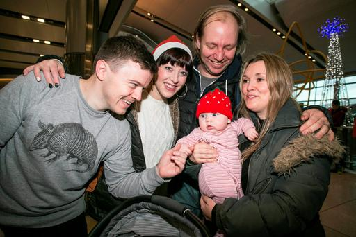 Five Month old Dolly Schenck is welcomed home from New York by her Uncle Cormac Brady and his Partner Aoife Byrne and his Sister Nell and Husband Ted Schenck pictured at Dublin Airport.