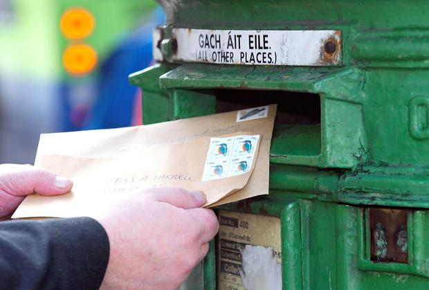 A Dublin postman was sacked by An Post after being caught having his girlfriend deliver post on his postal round. Stock image