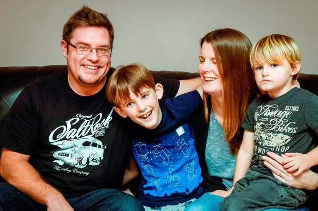 Nathan Crawford, 9, second left, with his younger brother Ned Alison, mother Donna Hunt and stepfather Jonathan Alison at their home in Bude, Cornwall. The nine-year-old with a brain tumour has become the first in the UK to have testicular tissue frozen with the hope he can have children later in life