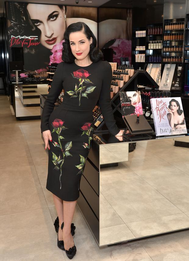 Dita Von Teese attends the MAC Comestics Dita Von Teese Collection Launch Event on December 11, 2015 at MAC North Beverly in Beverly Hills, California. Getty