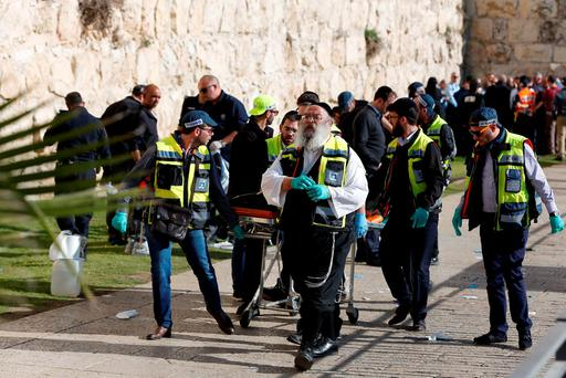Ultra-Orthodox Jewish Zaka volunteers carry away on a stretcher the body of a Palestinian assailant who was shot dead following a reported stabbing attack next to Jerusalems Old City Jaffa Gate Credit: AHMAD GHARABLI (AFP/Getty Images)