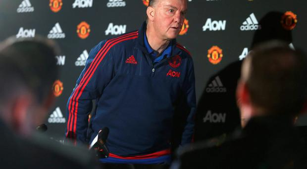 Louis van Gaal walks out of his press conference yesterday. Photo: John Peters/Man Utd via Getty Images