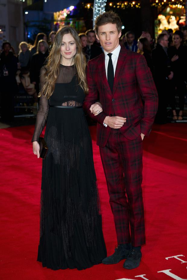 LONDON, ENGLAND - DECEMBER 08: Eddie Redmayne (R) and wife Hannah Bagshawe attend the UK Film Premiere of