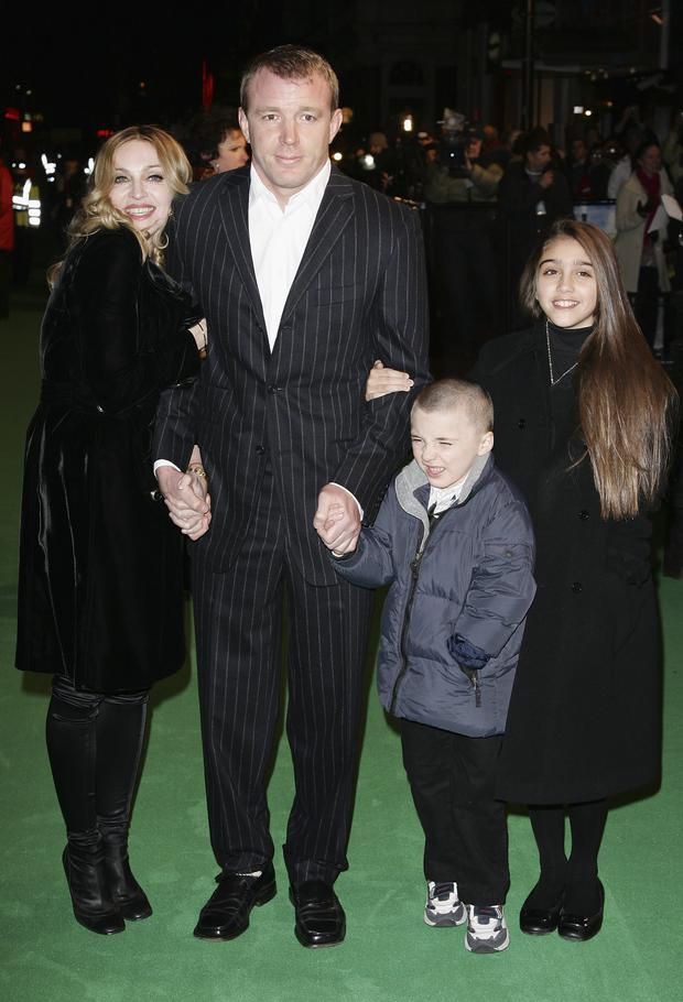 Singer Madonna arrives with her ex husband Guy Ritchie and children Rocco and Lourdes at the UK Premiere of