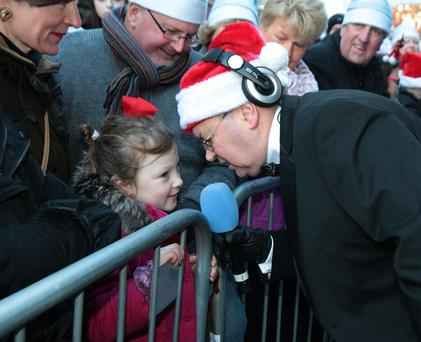 Joe Duffy with Jessica Carroll (7) pictured at RTE Radio 1's Joe Duffy Show Special Christmas broadcast from Grafton Street Dublin Picture Brian McEvoy