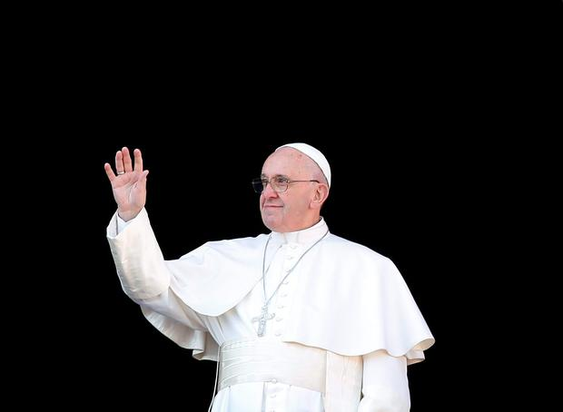 Pope Francis waves as he arrives to leads