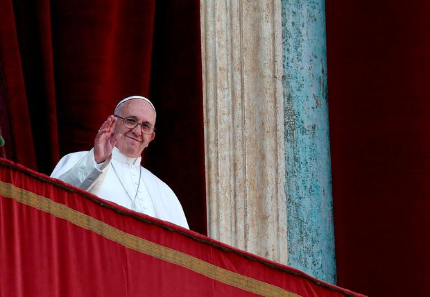 Pope Francis waves during the
