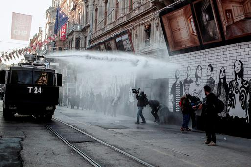 Police use water cannon and teargas to disperse people protesting against security operations against Kurdish rebels in southeastern Turkey, in Istanbul, Sunday, Dec. 20, 2015. (AP Photo/Cagdas Erdogan)