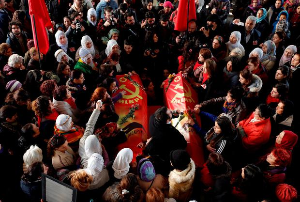 People carry the coffins of Sirin Oter and Yeliz Erbay, two women killed during security operations on Tuesday, during a funeral ceremony in Istanbul, Wednesday, Dec. 23, 2015. (AP Photo/Emrah Gurel)